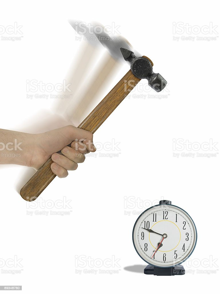 Alarm clock and hammer in hand royalty-free stock photo