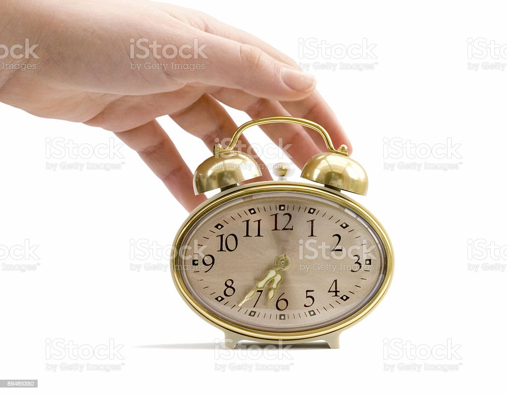 Alarm clock and hand on white background royalty-free stock photo