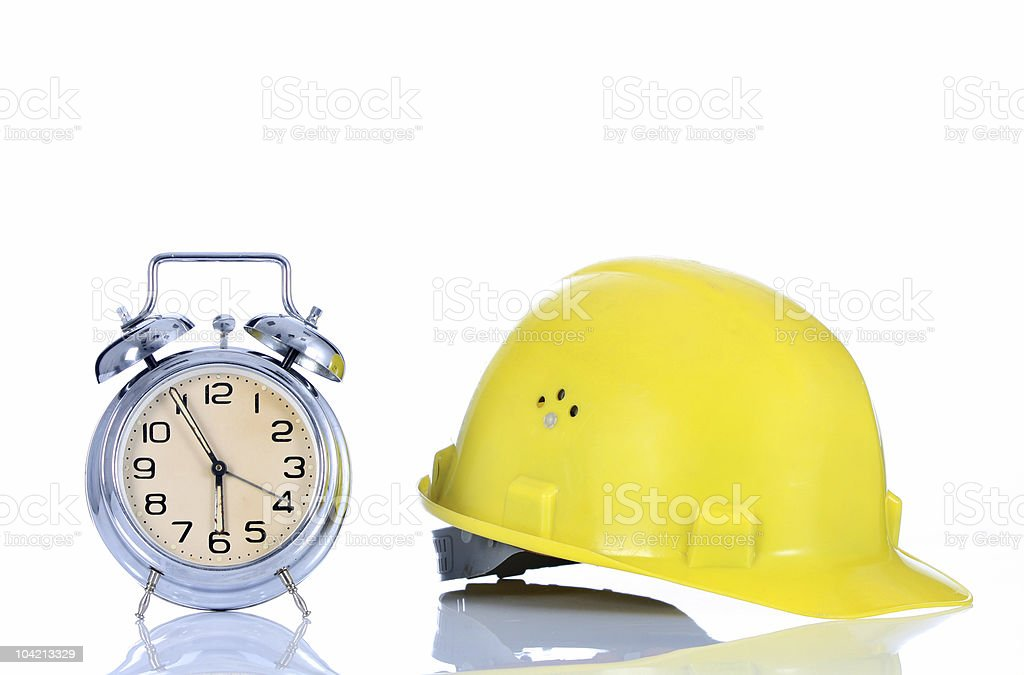 alarm clock and helmet royalty-free stock photo