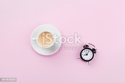 istock Alarm clock and morning coffee. Time to rest. Flat lay. 647626350