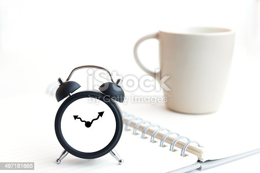 885959540 istock photo Alarm clock and notebook isolated on white 497181665