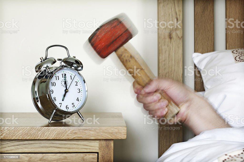 Alarm clock and sledgehammer royalty-free stock photo