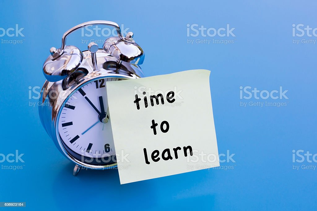 alarm clock and TimeTo Learn on sticker stock photo