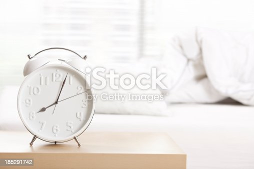istock Alarm clock at sleeping room. 185291742