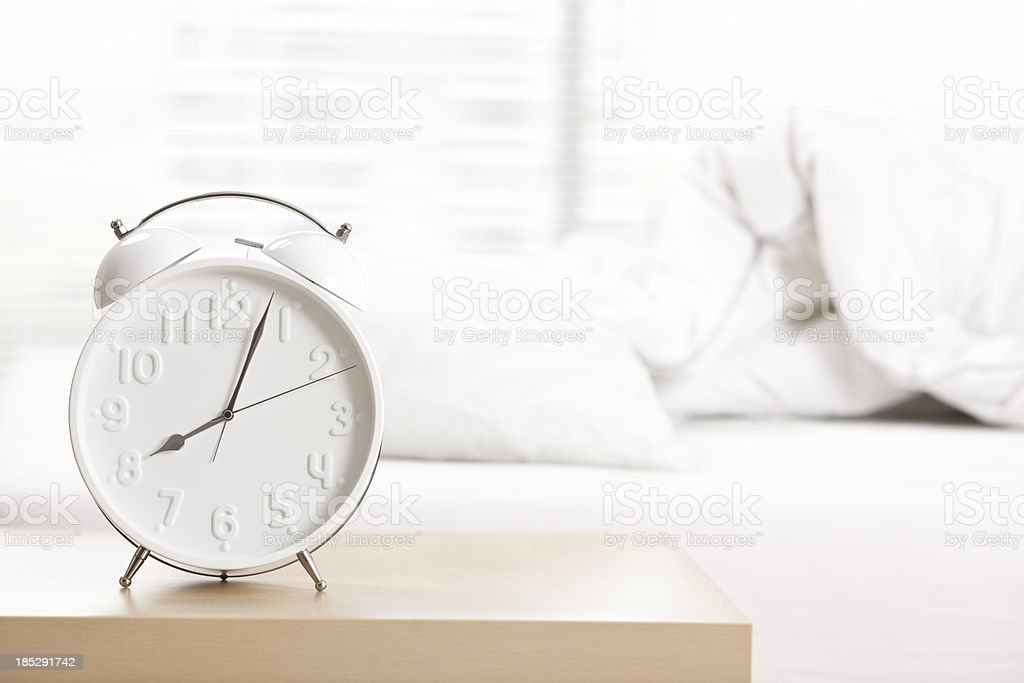 Alarm clock at sleeping room. stock photo