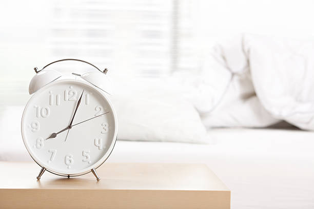 alarm clock at sleeping room. - alarm clock stock photos and pictures