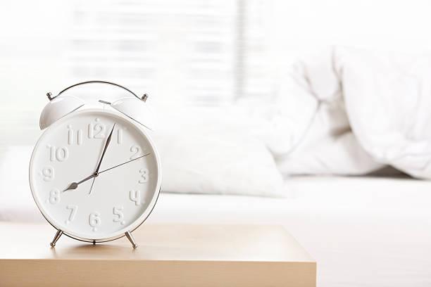 Alarm clock at sleeping room. stock photo