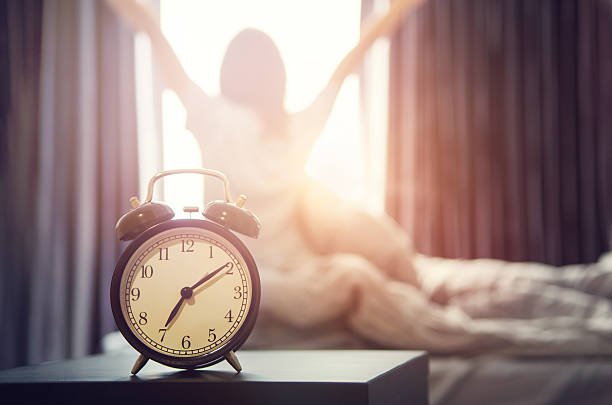 alarm clock having a good day in morning. - alarm stock pictures, royalty-free photos & images