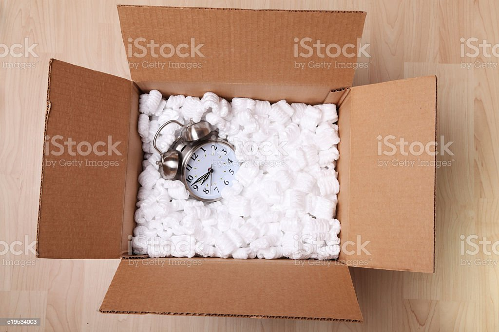 Alarm clock in a box stock photo