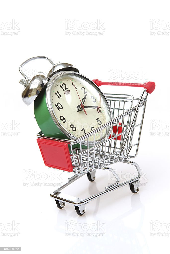 Alarm clock in a shopping cart royalty-free stock photo