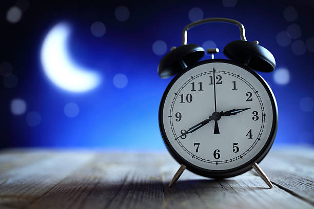 Alarm clock in the middle of the night insomnia stock photo