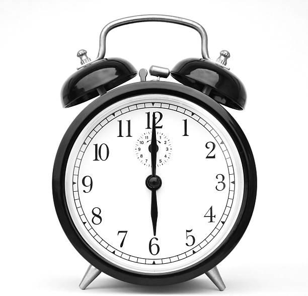 Alarm clock isolated on white stock photo