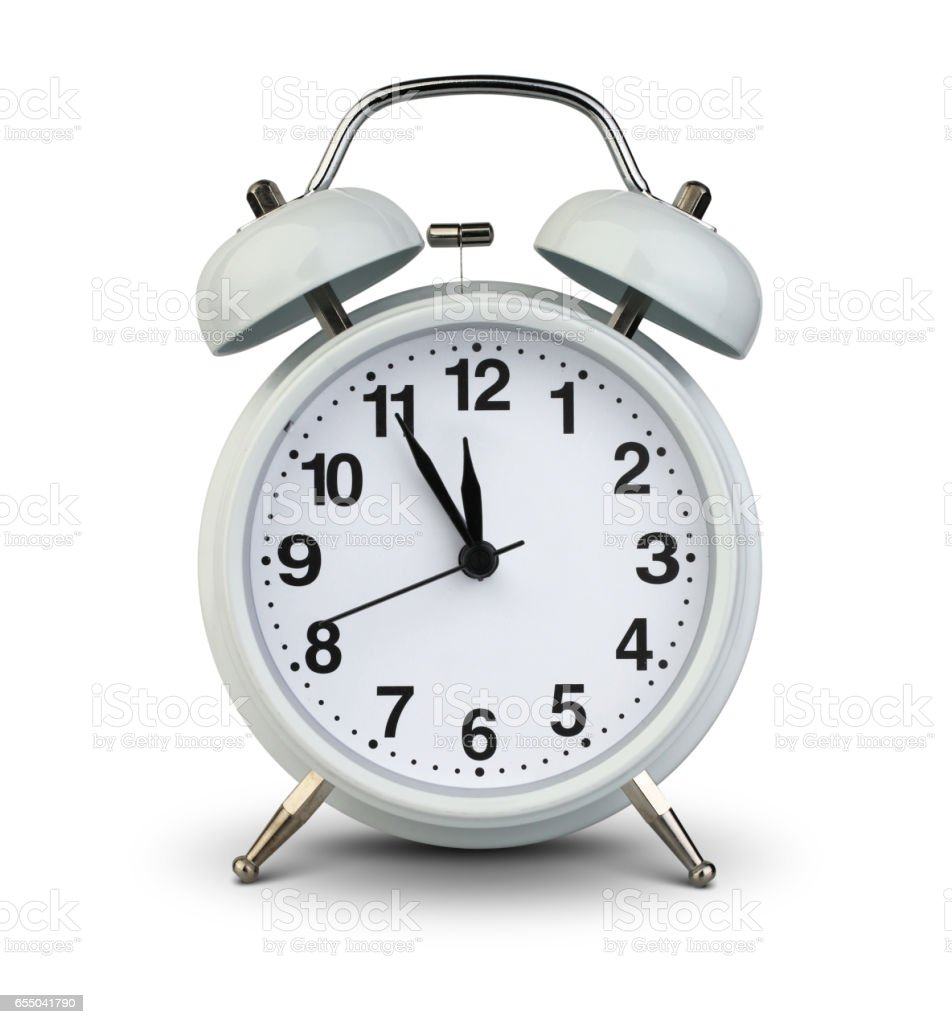 Alarm clock isolated on white with clipping path, five minutes to twelve stock photo