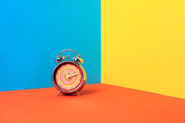Alarm clock on a color background Alarm clock on a color background countdown stock pictures, royalty-free photos & images