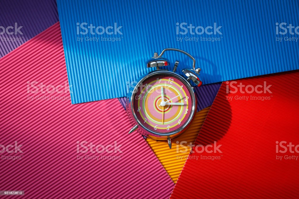 Alarm clock on a color background stock photo