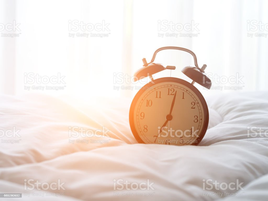 Alarm Clock On Bed In Morning With Sun Light Stock Photo Download Image Now Istock
