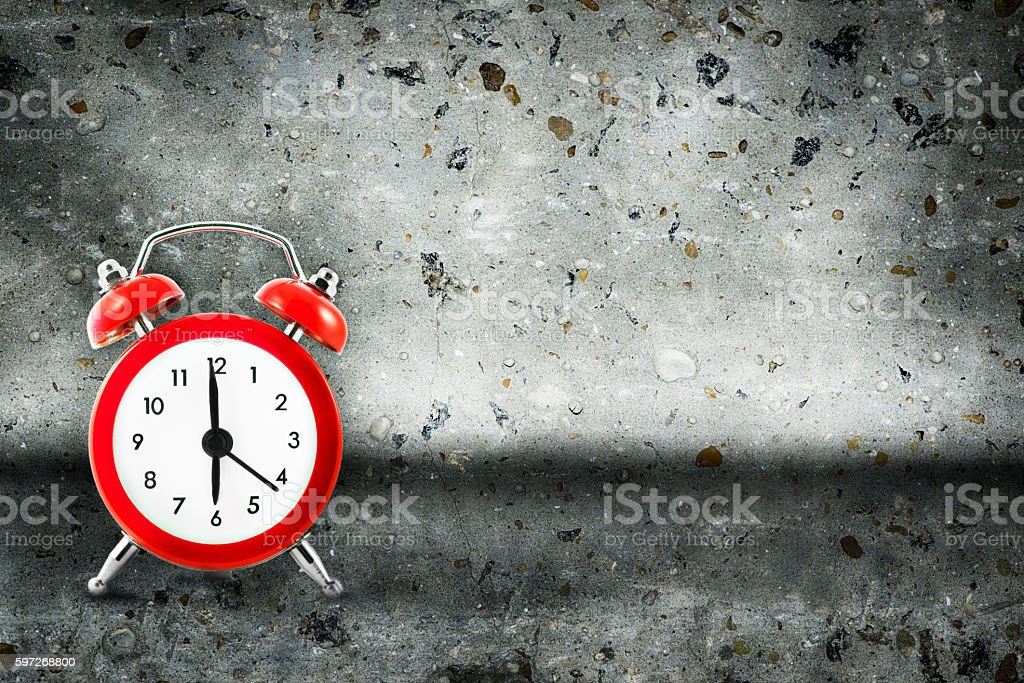 Alarm clock on concrete background Lizenzfreies stock-foto