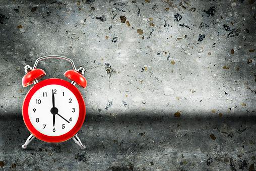 Alarm Clock On Concrete Background Stock Photo & More Pictures of Alarm Clock