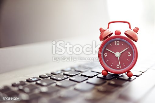 istock Alarm clock on laptop 520544094