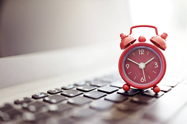 alarm clock on laptop - deadline stock pictures, royalty-free photos & images