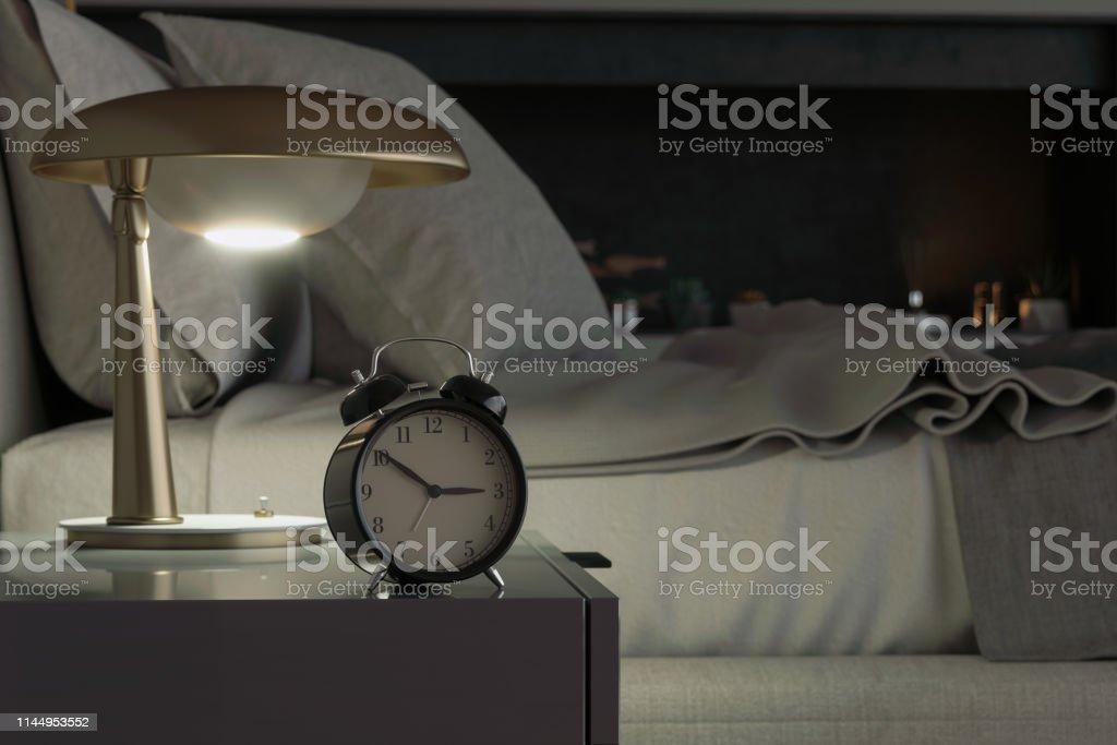 Alarm clock on night table in bedroom