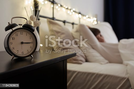 istock Alarm Clock on Night Table 1134263923