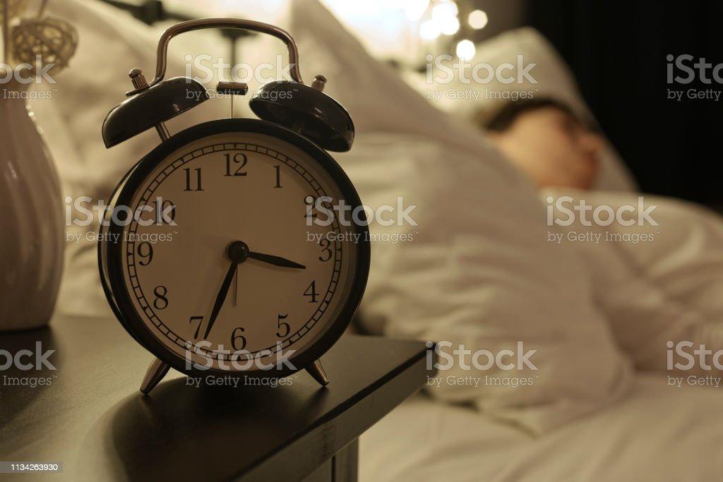 Alarm clock on night table