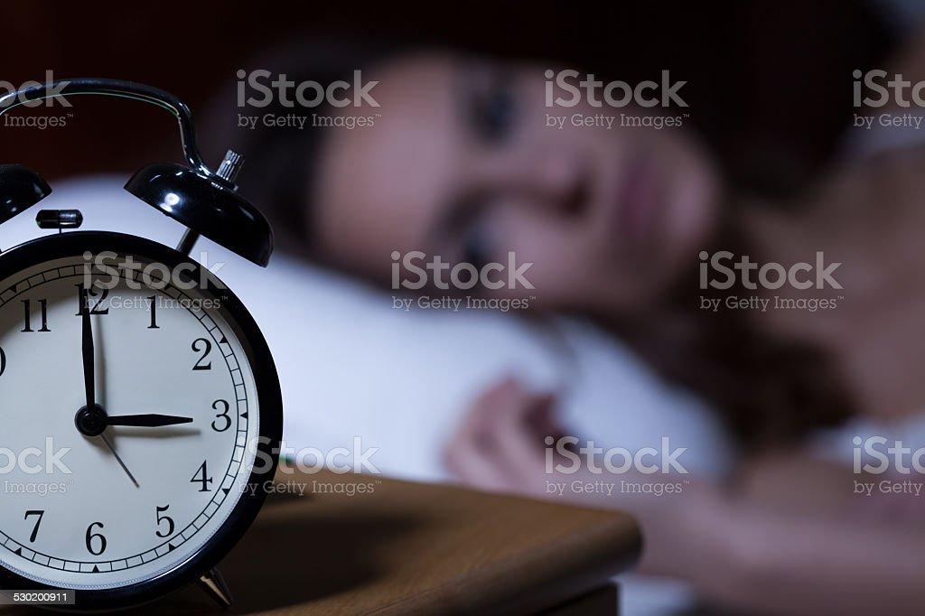 Alarm clock on night table stock photo