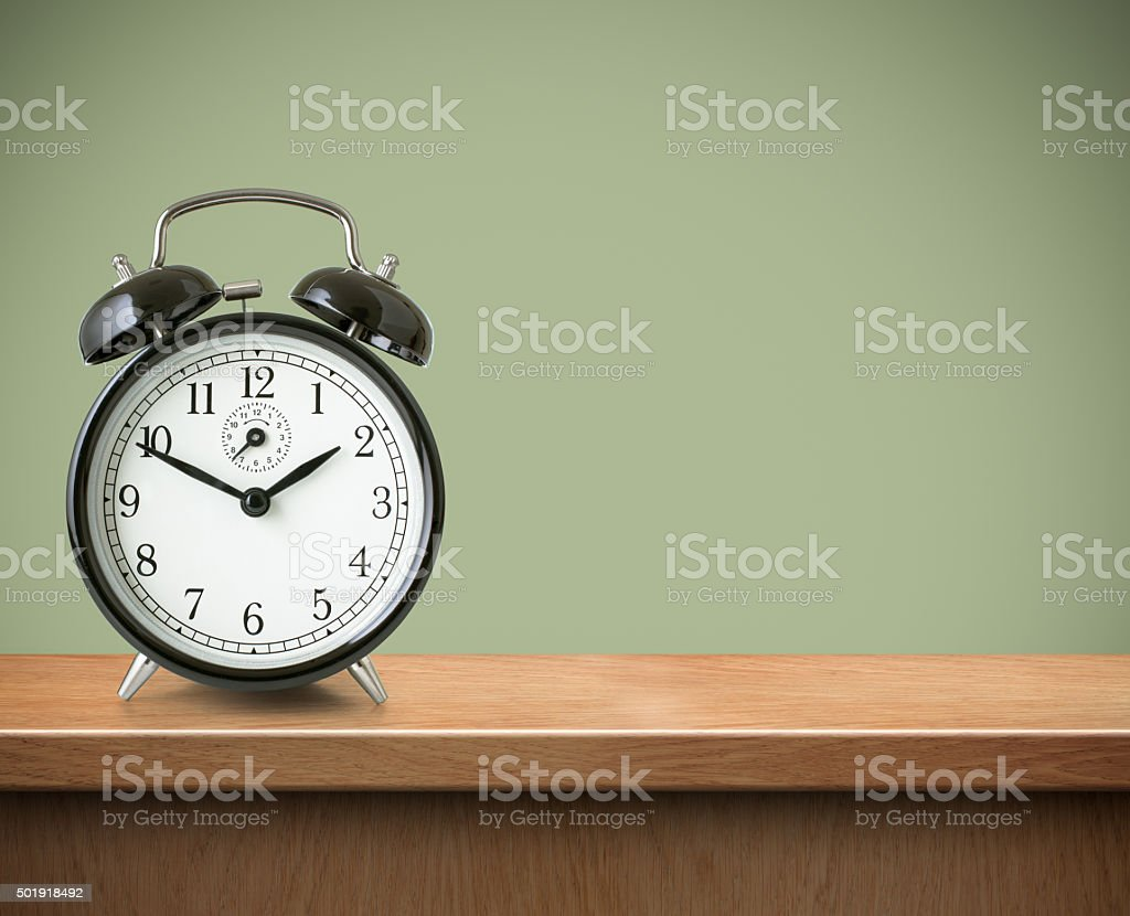 Alarm clock on table or shelf background stock photo