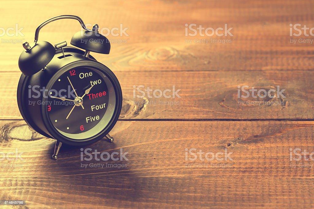 Alarm Clock On Wood Table stock photo