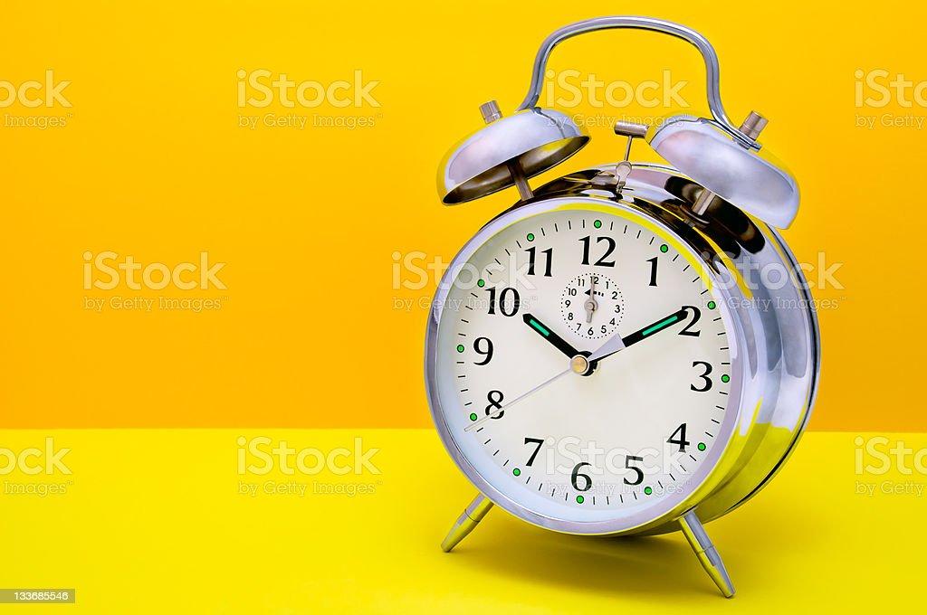 Alarm Clock - Orange and yellow background royalty-free stock photo