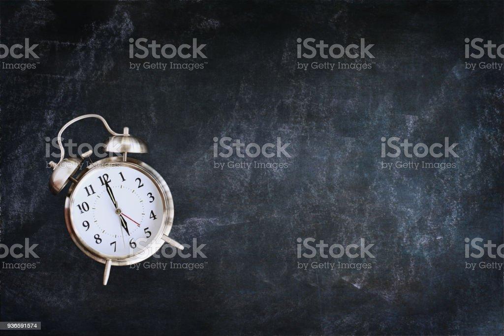 Alarm Clock over Chalkboard stock photo