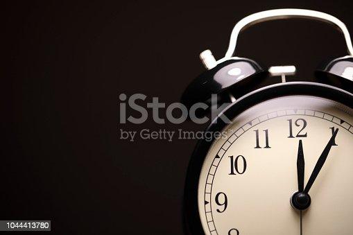 Retro Alarm Clock At Dark Background