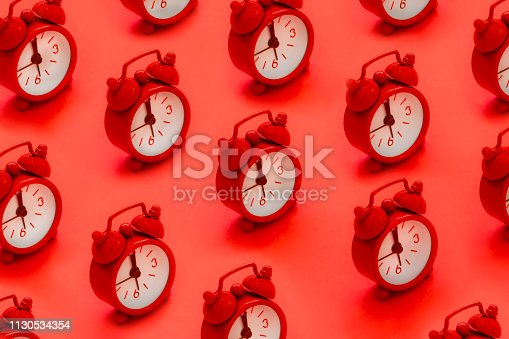 Alarm clocks on red background