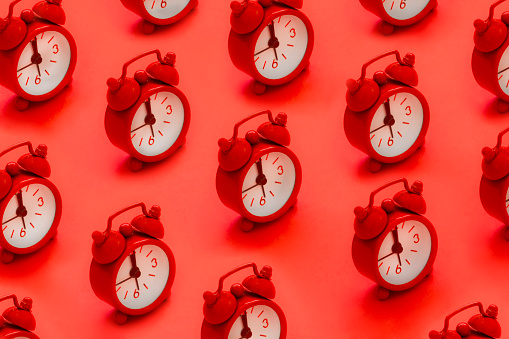 Alarm clocks on red background