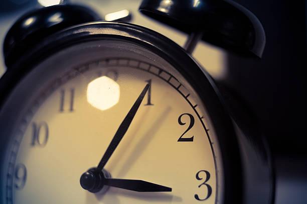 Alarm clock Alarm clock on dark background, adobe rgb 1998 use........... daylight savings stock pictures, royalty-free photos & images