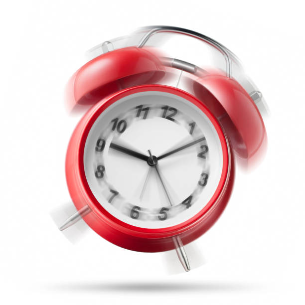 alarm clock ringing on white background - alarm clock stock photos and pictures