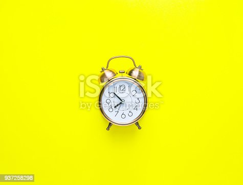 istock Alarm Clock Showing Eight O'Clock on Bright Yellow Background. Flat Lay. Morning Sunlight. New Day Beginning Waking Up Energy Concept. Copy Space Mock Up Template 937258298