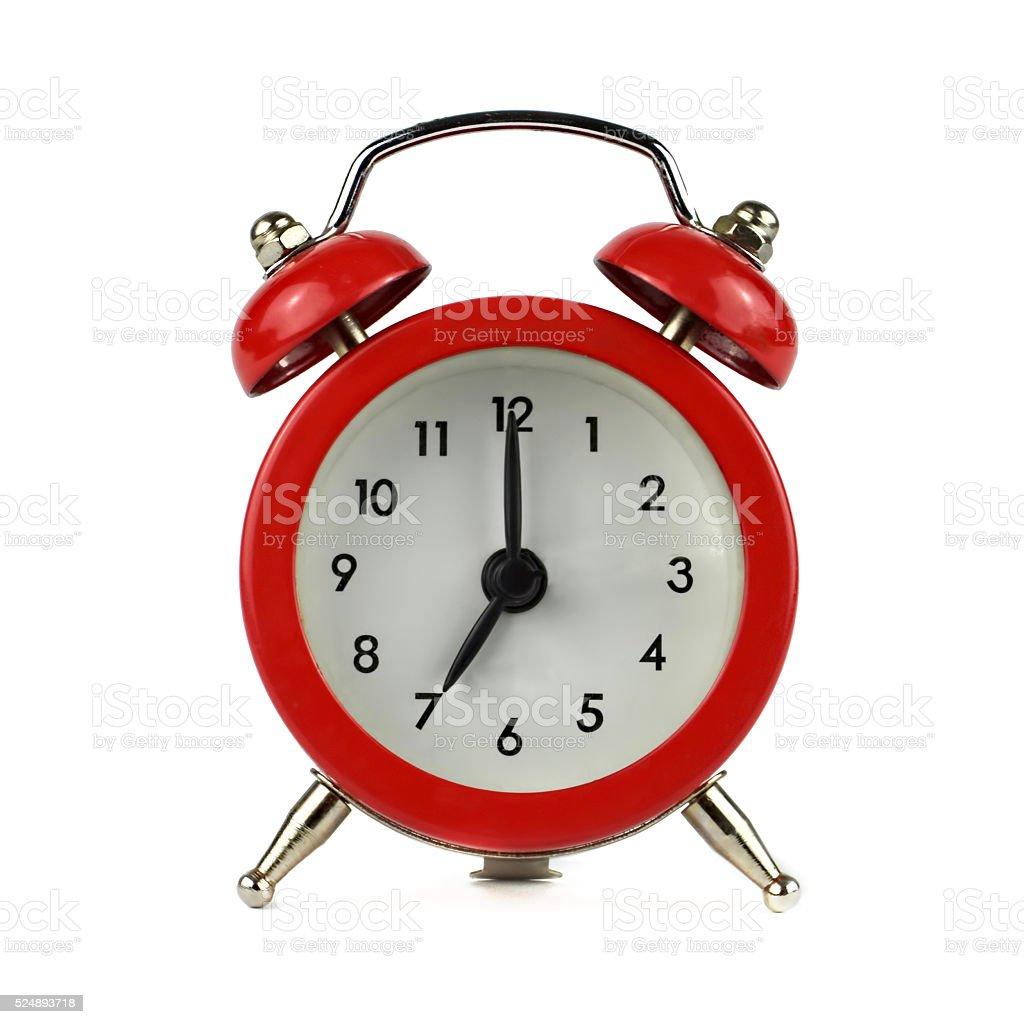Alarm clock showing seven o'clock stock photo