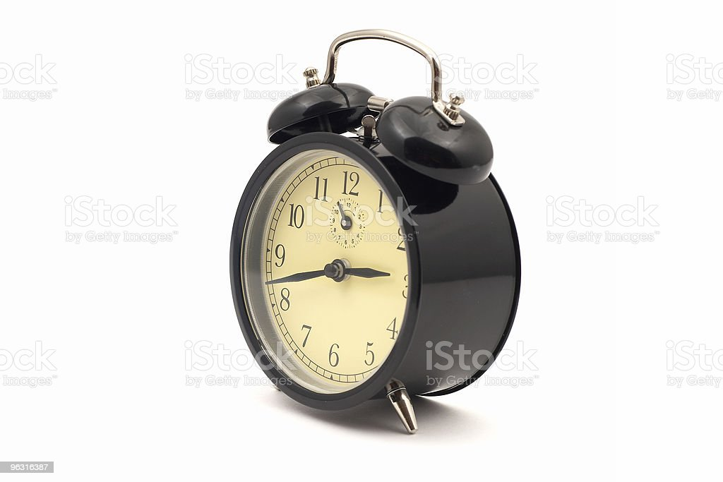 Alarm clock standing on white background stock photo