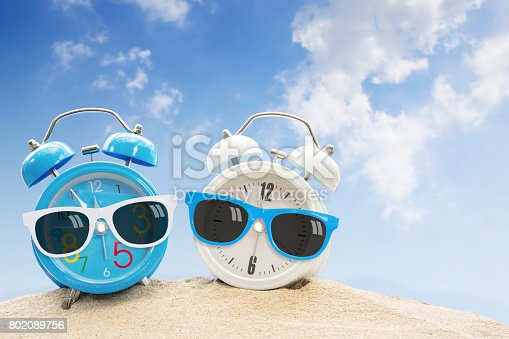 905623256 istock photo Alarm clock summer time 802089756
