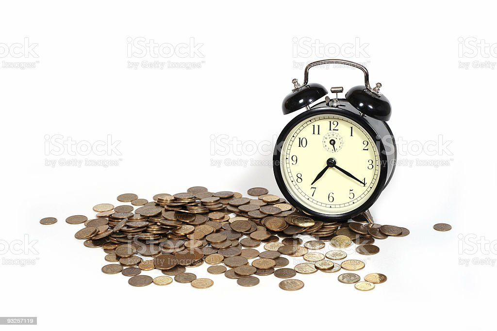 Alarm clock with a pile of pennies on white background stock photo