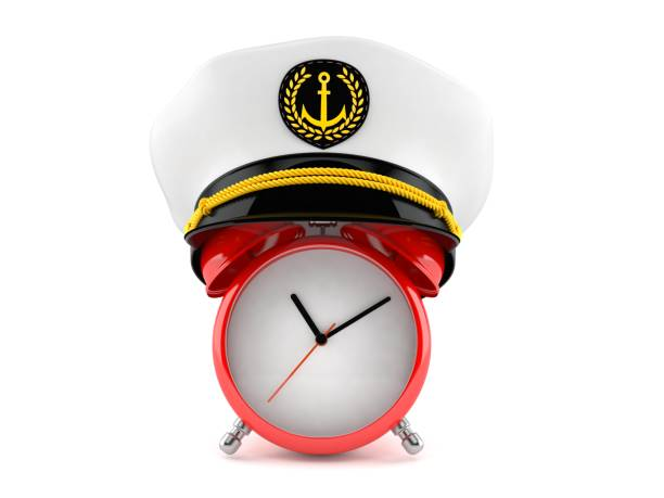 Alarm clock with captain's hat Alarm clock with captain's hat isolated on white background. 3d illustration sailor hat stock pictures, royalty-free photos & images