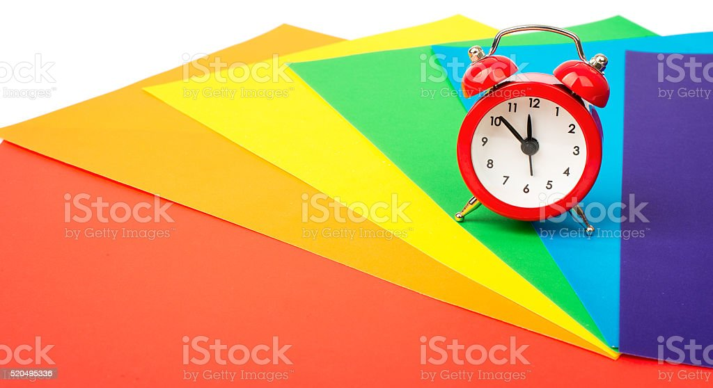 Alarm clock with colorful paper stock photo