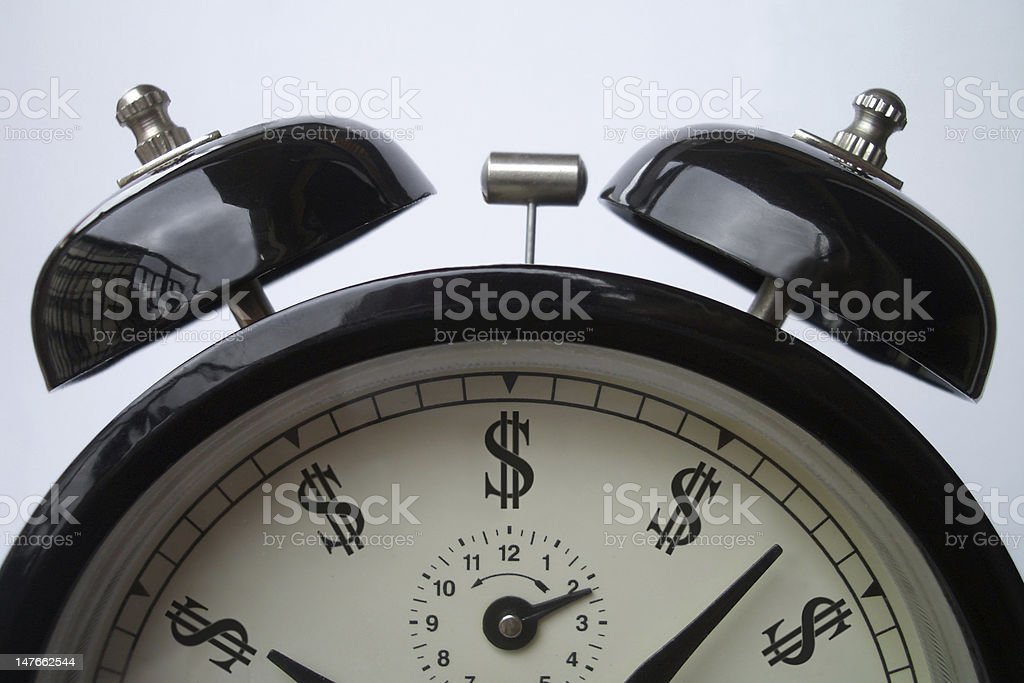 Alarm clock with dollar symbols instead numbers royalty-free stock photo