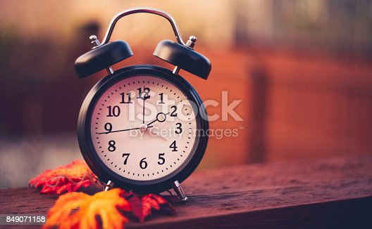 istock Alarm clock with fall leaves Daylight Savings Time 849071158
