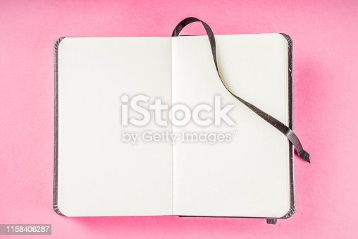 1090161334 istock photo Alarm clock with notepad on bright pink table 1158406287