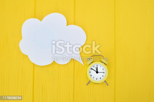 istock alarm clock with speech bubble. concept of time consuming on communication, with place for your text 1178036234
