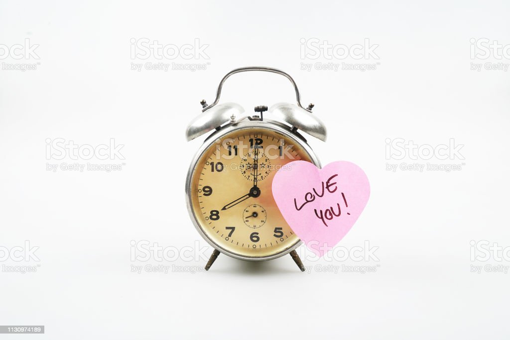 Alarm clock with text 'love you' stock photo