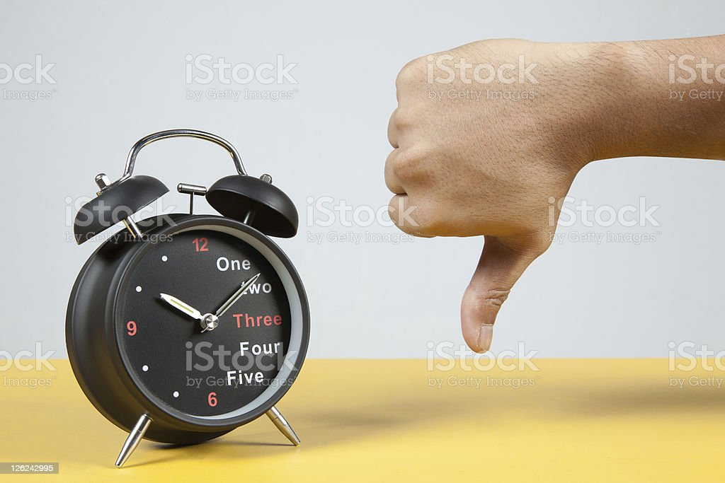 Alarm Clock with Thumb Pointing Down royalty-free stock photo